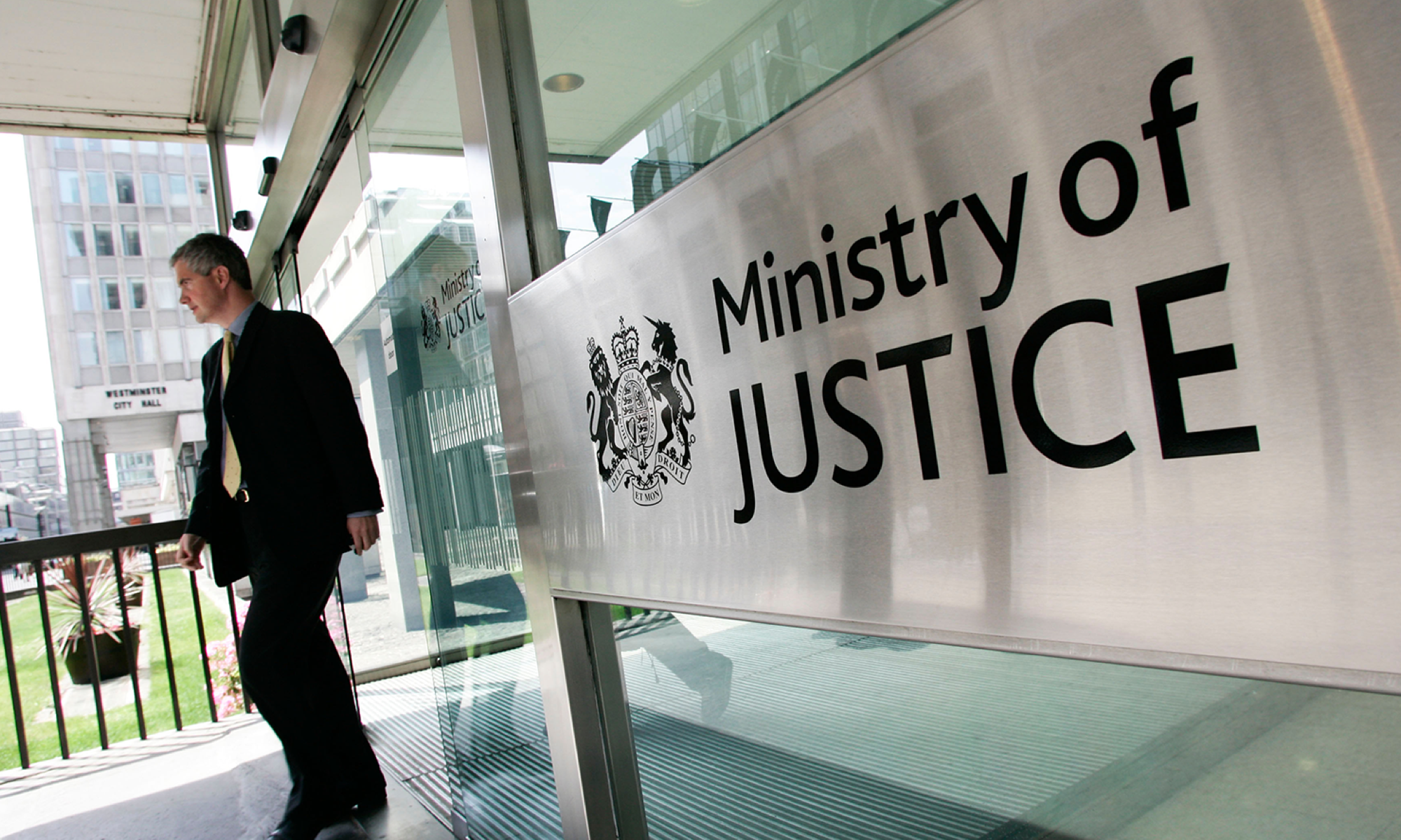 Person leaving Ministry of Justice building