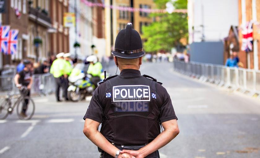 Policeman standing in street