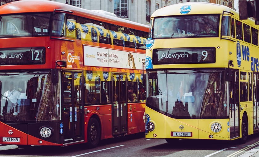 Two buses on a street